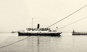An original photograph of the Nomadic serving as a tender in Cherbourg Harbor. This photograph, which was mixed in with a batch of Cherbourg and Southampton pictures, probably dates to the late 1920's to early 1930's. Because of the dark color of her funnel, it seems possible that the photograph was taken after she was purchased from Cunard-White Star (in 1934) and re-named Ingenieur Minard. (J. Kent Layton Collection)