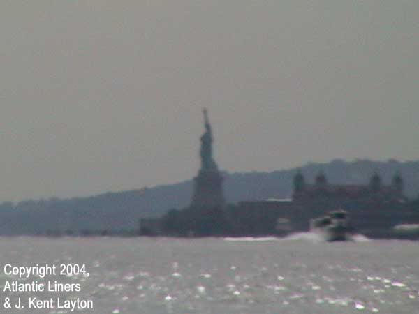 Standing on the end of Pier 54, looking south and west, in the distance stands the Statue of Liberty - the symbol to so many immigrants that their new life was beginning. (Photo by J. Kent Layton)