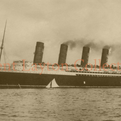 A small sailing vessel ventures close to the side of the Lusitania before she begins her trials. (J. Kent Layton Collection)