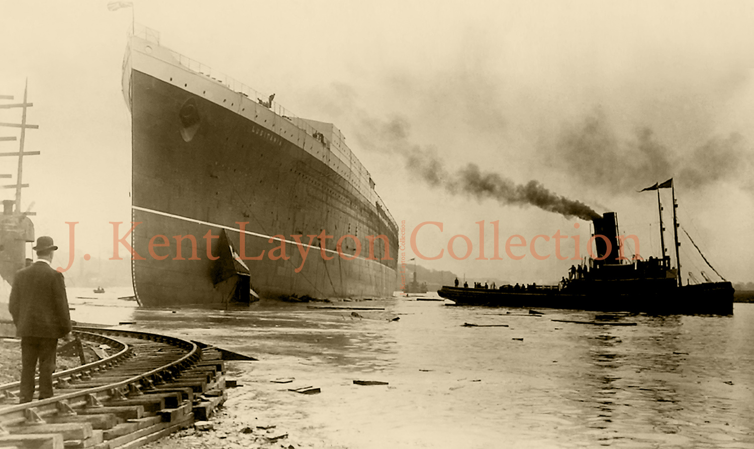 Shortly after the launch, tugs take the Lusitania in tow, shepherding her toward the fitting out basin. (J. Kent Layton Collection)
