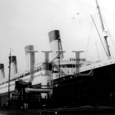 A late career photograph of the Olympic with a tug alongside, likely in Southampton. (J. Kent Layton Collection)