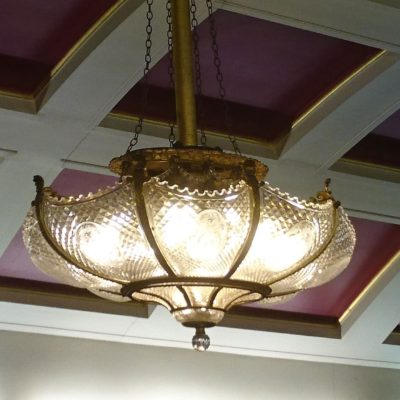 In additional to the large, central electrolier, four oval and eight circular lights of a similar style were spread around the room. This is one of the oval ones. (Pavel Chlupac)