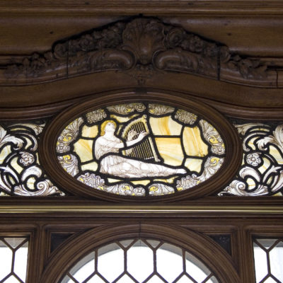 A stained glass window from the Lounge. The upper portion poked above the Boat Deck and allowed unobstructed daylight to enter from outside. (Wikimedia Commons)