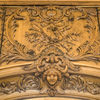 This piece of paneling once stood over the set of double doors that led aft from the Lounge toward the aft Grand Staircase. Its counterpart from Titanic is now in the Maritime Museum of the Atlantic, and served as inspiration for the