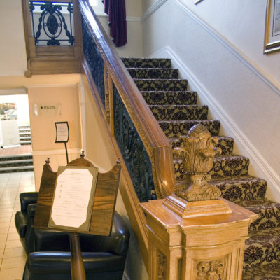 The balustrade from the First Class Grand Staircase at the White Swan. (Wikimedia Commons)